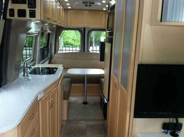"""2014 Used Pleasure Way Plateau Fl Class B in Florida FL.Recreational Vehicle, rv, 3.0L V6 Diesel Mercedes Benz Sprinter Chassis. Dual rear wheels, gives a very stable ride. 75"""" interior standing height. Dometic Air Conditioner Gets 20 MPG Electrically operated rear sofa folds down into a queen sized bed, room for the table, too. Motorized Carefree awning is out and secured, in just minutes. Kitchen includes Dometic refrigerator/freezer, Sharp Convection microwave oven, two burner propane…"""