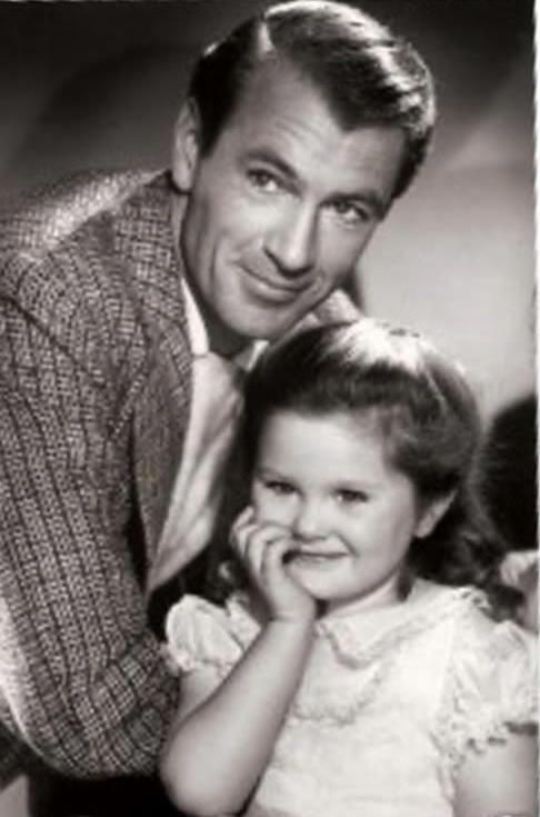 Gary Cooper with daughter Maria, born in 1937. He was ...