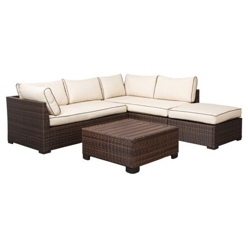 This 4-piece outdoor sectional set's clean architectural lines and supportive cushioning make being outside even more inviting. All-weather reversible Nuvella™ cushions are finessed with brown piping, and complement the richly hued wicker frames perfectly. Square cocktail table and ottoman cozy up to the sectional with ease. Signature Design by Ashley is a registered trademark of Ashley Furniture Industries, Inc.