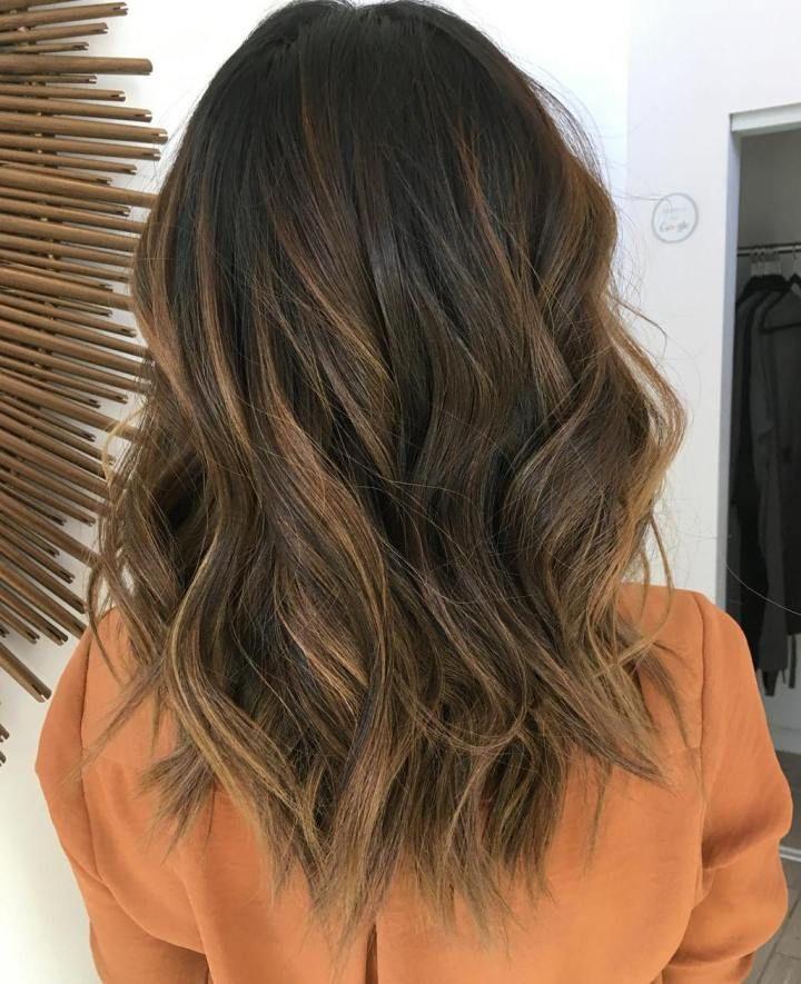 medium dark brown hair with caramel balayage