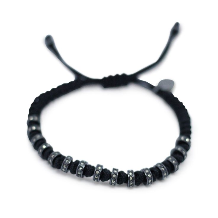 Hand crafted black rhodium beaded stopper bracelet and swarovski set stones with signature GJ pendant