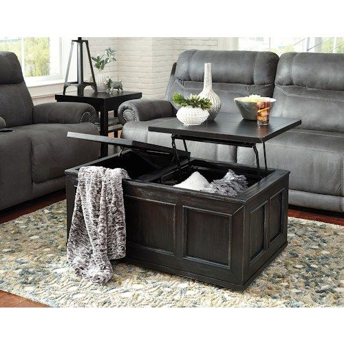 Gavelston Rustic Distressed Black Trunk Style Lift Top Cocktail Table W/  Casters By Signature Design By Ashley