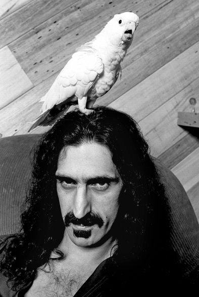 Frank Zappa at home with Bird Reynolds, Hollywood Hills, 1979