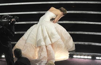 Jennifer Lawrence trips up the #Oscars stage to accept her Award #Oscars2013.