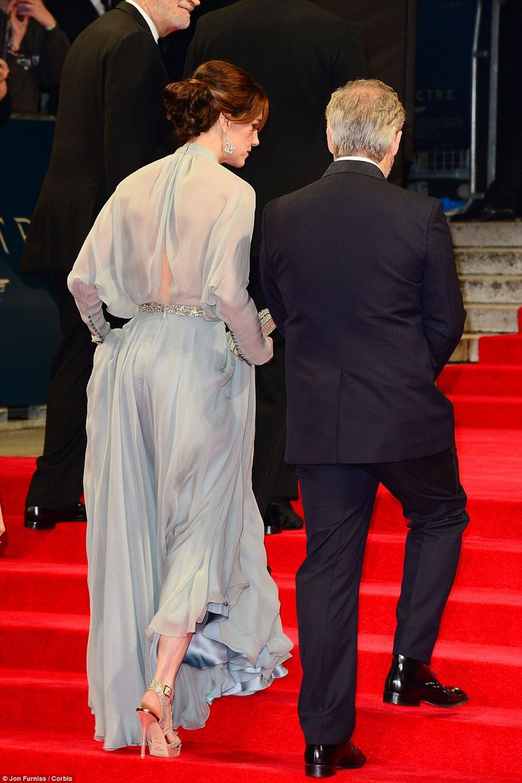 26.10.2015 The Duchess of Cambridge and director Sam Mendes climb the stairs for the Royal World Premier of Spectre, with Kate showing a hint of leg and her glitzy Jimmy Choos