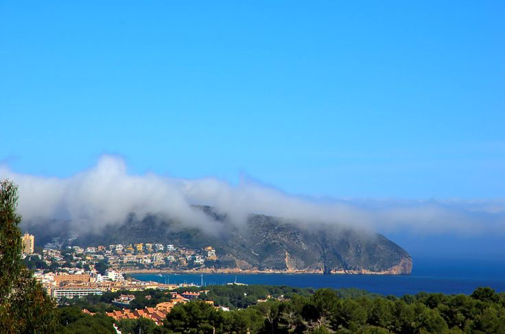 The bay of #Moraira after a cloudy morning. Some of the clouds still resting on Cap d´Or
