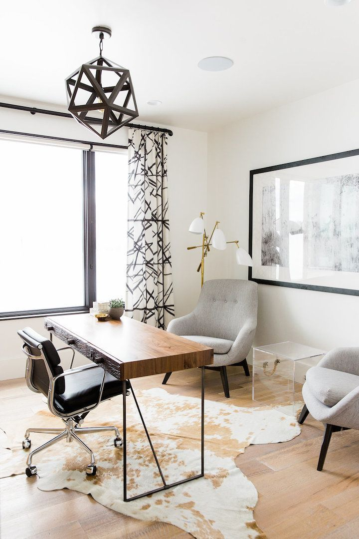 Home decorating ideas - home office in modern rustic style with geometric light pendant, upholstered chairs, hide rug, large art work | studio mcgee