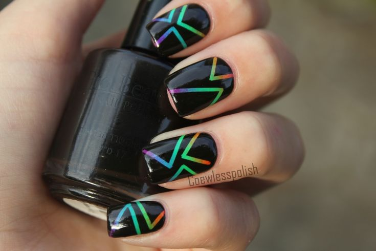 Neon gradient under black with triangle shapes (masked with striping tape) nail art design