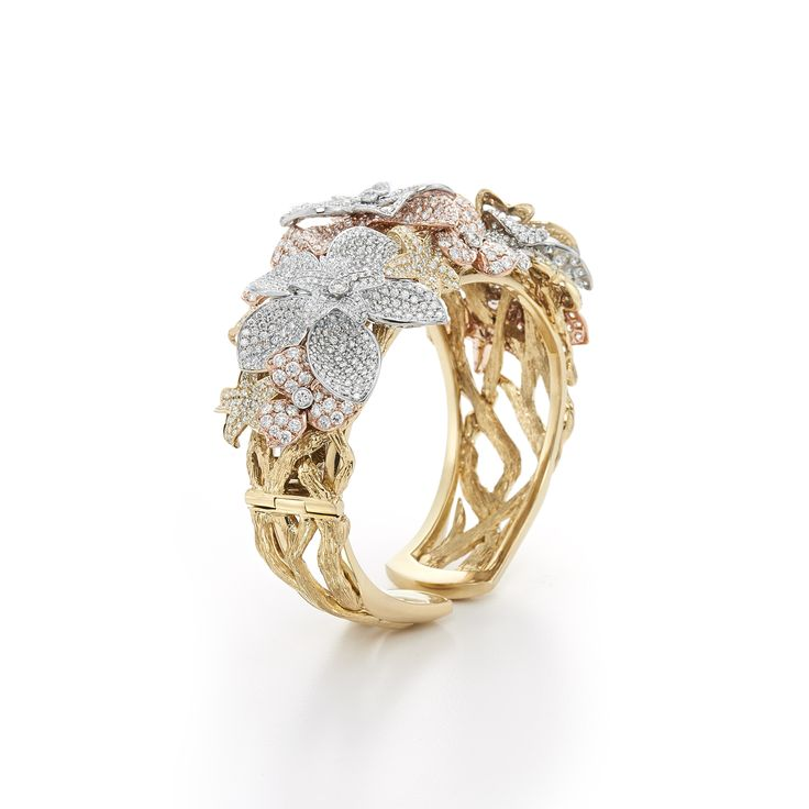 Diamond cuff in 18k yellow, white and rose gold. Lotus Diamond Bracelet by Kwiat