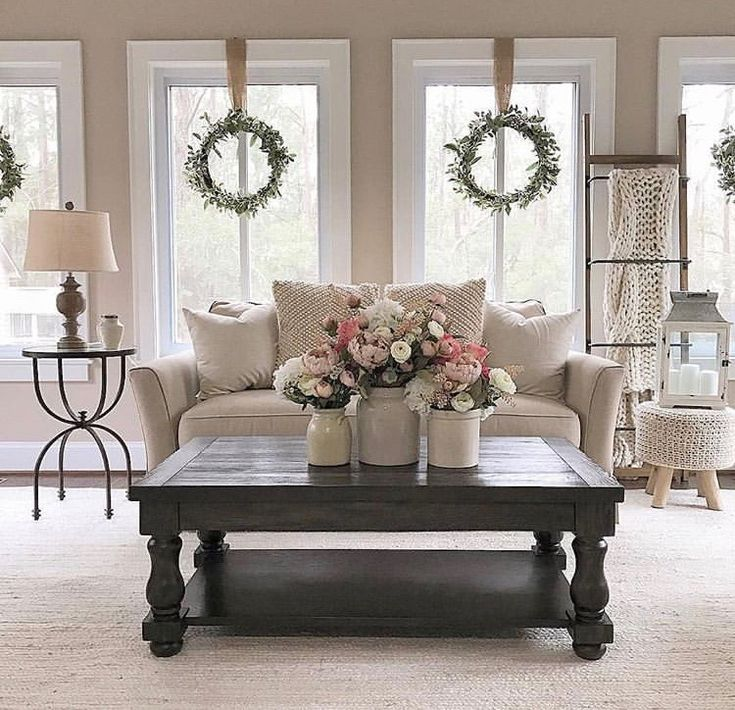 Beautiful White Living Room Lots Of Windows With Greenery Wreaths Hung By Ribbo Beauti Spring Living Room Decor Spring Living Room Farm House Living Room