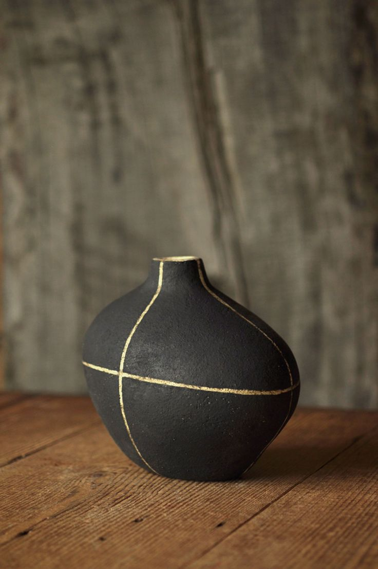 yoko komae, the black nest., black ceramic vase with white graphic stripes - shape and decoration remind of mid century style