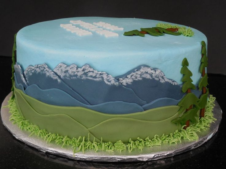 www.cakecoachonline.com - sharing...A Cake for an avid outdoorsman. Some snowcapped mountains. Love the layering of decoration on this!