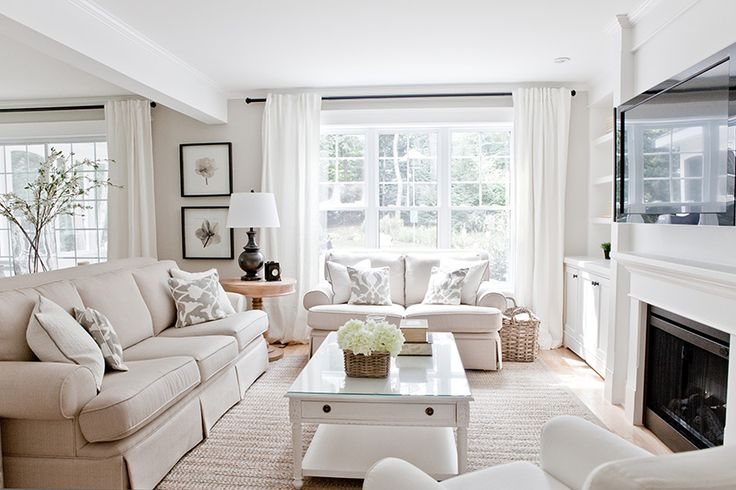 bright beige living room sheer curtains white fireplace large area