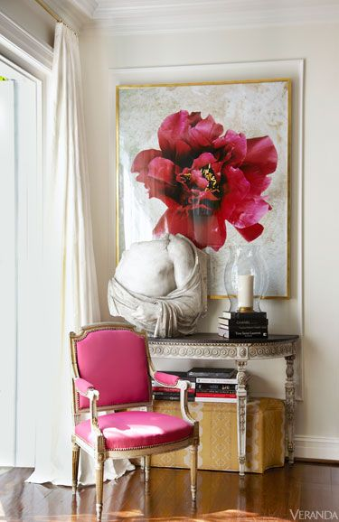 gorgeous entry way with pink upholstered chair and oversized art work in a glamourous richmond home