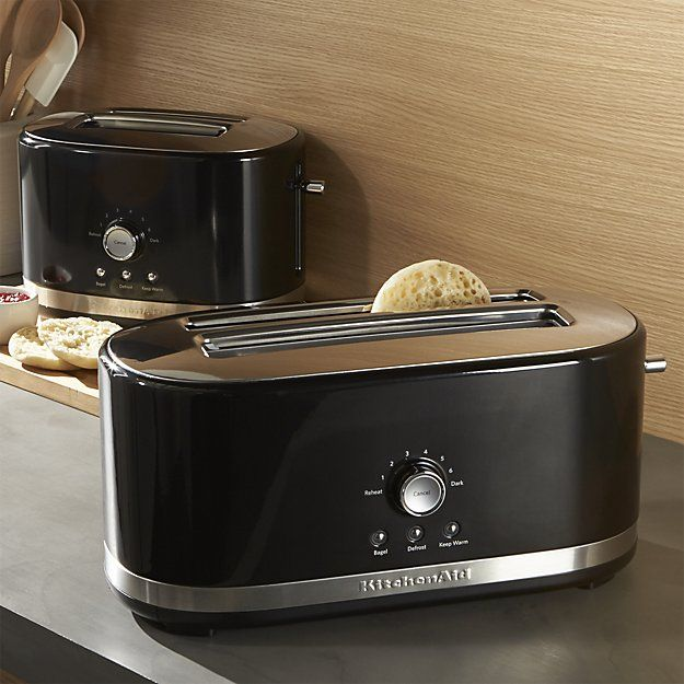High-performance and durability define these modern toasters with that signature KitchenAid style and engineering. Updated with an oval design, these sleek black toasters offer extra wide 1.5-inch slots, seven browning shades and special functions for bagels, defrosting and reheating. The keep-warm function operates for up to three minutes, while the lift-and-see feature lets you check progress and extra-high lift makes it easy to retrieve English muffins and smaller slices.