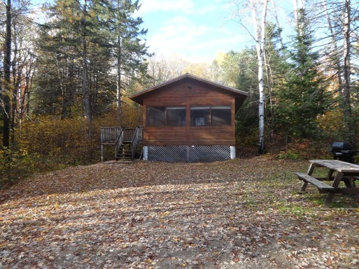 Ready-to-Camp Lodgings Two (20' x 20') square pine log cabins situated on the…