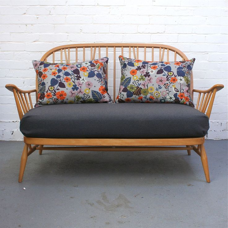 Very cute Ercol 2 seater, waiting to be customer to choose it's new seat cover!