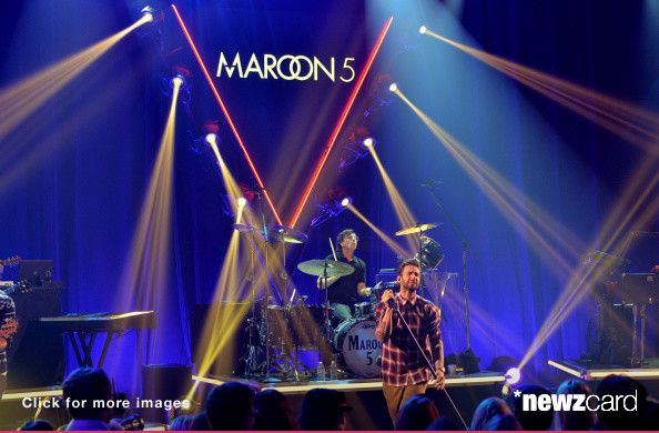 Musician Matt Flynn (L) and singer Adam Levine of Maroon 5 perform onstage druing the iHeartRadio Album Release Party with Maroon 5 LIVE on the CW at iHeartRadio Theater on August 26, 2014 in Burbank, California. (Photo by Kevin Winter/Getty Images for Clear Channel) -- Access, discover and share millions of images at *newzcard.com.