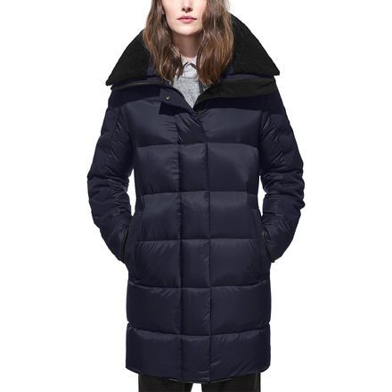The sophistication of the Canada Goose Women's Altona Parka will carry you through the work day and into an evening at the theater. This stylish parka is filled with goose down for impressive warmth, and the low-profile nature of this insulation works with the extended hem of the parka to give you a streamlined look. Arctic Tech fabric resists light precipitation and wind, so there's no need to worry about getting caught in a flurry while waiting for the valet.