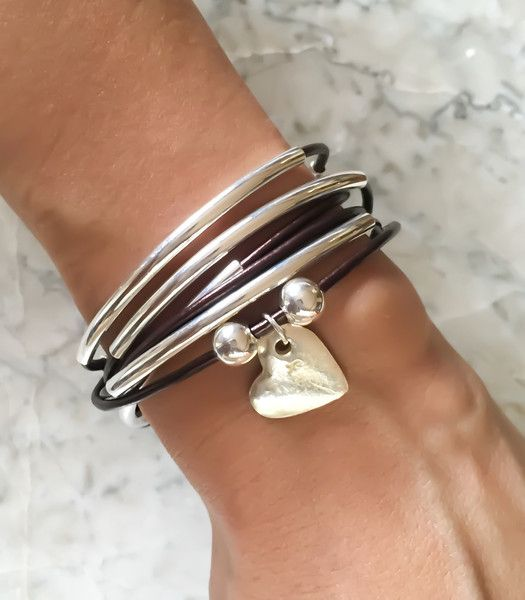 The Girlfriend wrap with hammered heart charm is a 2 strand leather wrap charm bracelet that can also be worn as a necklace. Made in America.