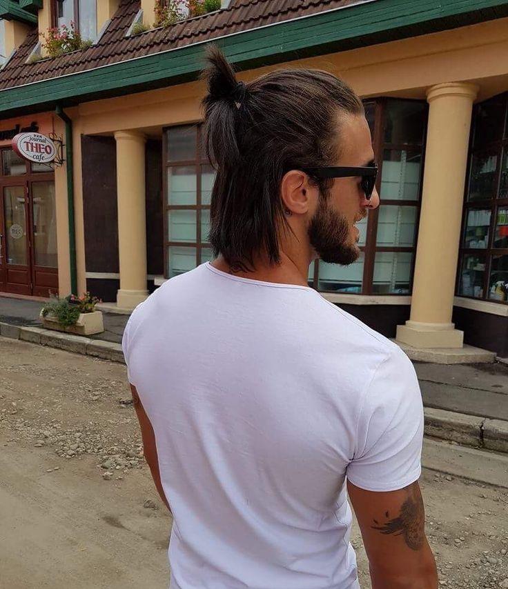 Men with long hair bun