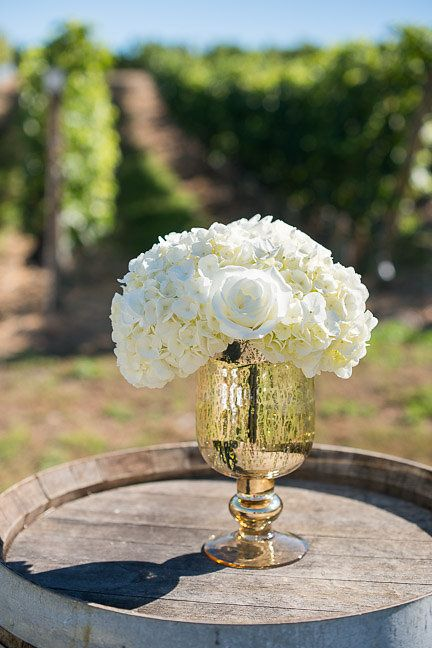Clean white florals in gold mercury glass.