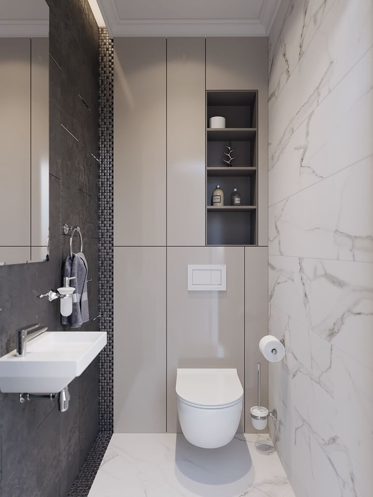 Small bathroom with a ton of hidden back wall storage. Minimal and contemporary
