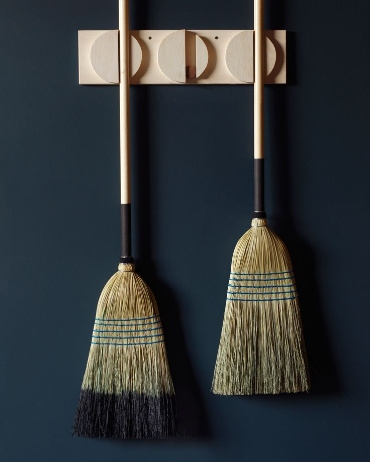 Our barn brooms are workhorses but store neatly on our triple broom holder.