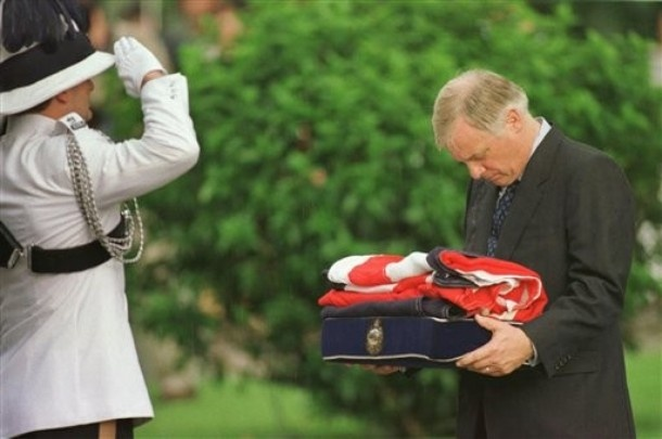 Chris Patten receiving the flag from Government House, 30/6/1997