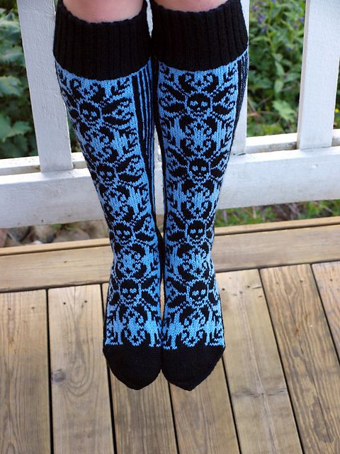 "Ravelry: Piikupikkuinen's Selbudeath. Knitted stockings or socks: ""Selbudeath"" by Erica Grønntun. Selbu is a small place in Norway, famous for their traditional knitted rose pattern: ""Selburose"". Here is an updated version in black and blue with skulls. Skulls are cool!"