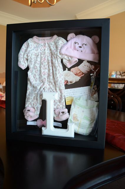 The going home outfit shadowbox I made. So simple! Bought the shadowbox from Hobby Lobby and simply pinned all the keepsakes from the hospital in place! Click pic for more details.