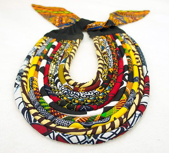 This beautiful kente print and wax print statement necklace is made by hand and can be worn any season. This necklace ties behind the neck.