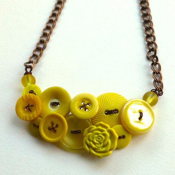 Shades of Yellow Vintage Button Necklace by buttonsoupjewelry, $30.00 This necklace is a combination of yellow buttons and beads on wire. It has large double link copper chain with a lobster clasp.
