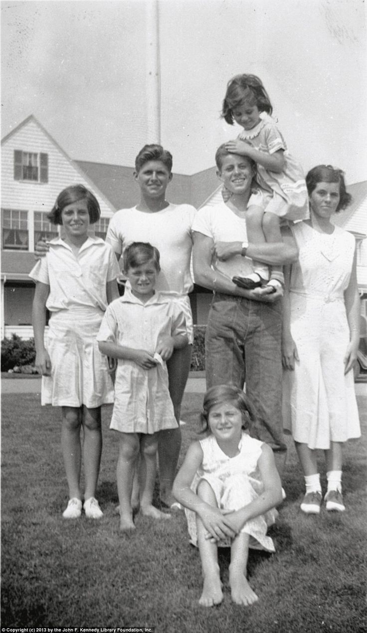 Home base: Eunice, Bobby, Joe Jr., Jack holding Jean, Rosemary, and Pat (sitting) at the family compound in in Hyannis Port, Massachusetts, in 1933