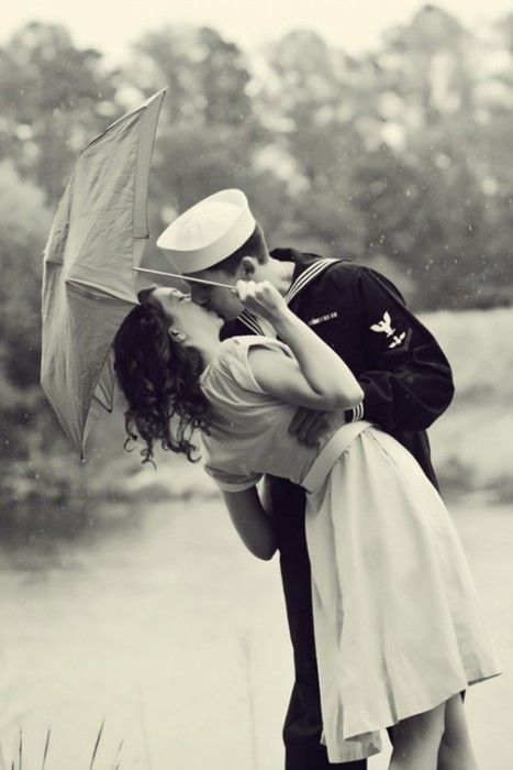 i eventually want one of these like 1950's style couple with the military guy and them kissing picture blown up and hung on the wall. but i want the rustic look, not the picture on the wall look.