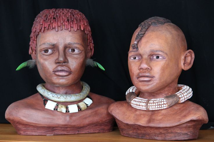 African busts.  Hand built from brick red clay, fired and coloured with shoe nugget.