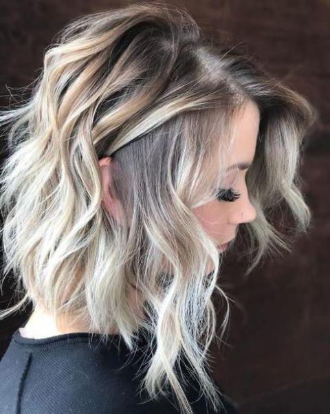 medium layered bob haircut with blonde balayage on light brunette hair