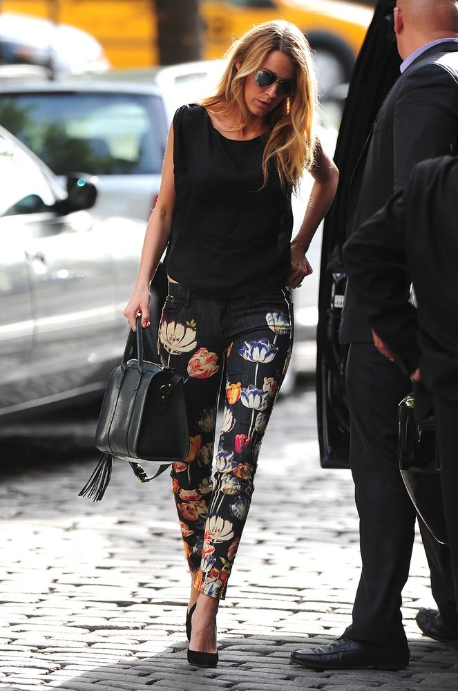 Black floral print trousers +black vets and handbag
