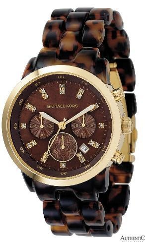 tortoise shell and gold large face watch.