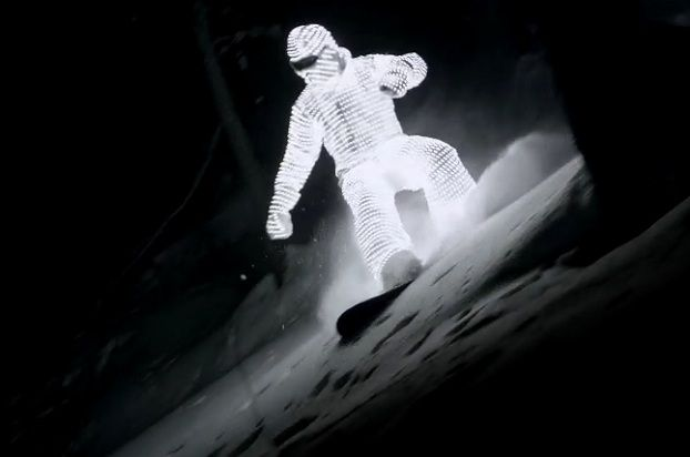 William Hughes snowboards in an LED-clad suit. Image via video screenshot.