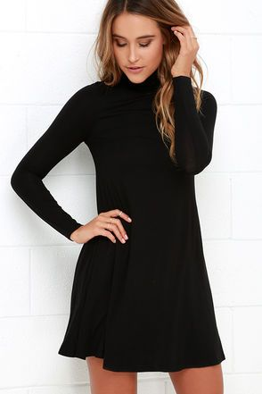 With infinite styling possibilities, the Sway, Girl, Sway! Black Swing Dress will be a welcomed addition to your wardrobe! Super soft jersey knit fabric shapes a relaxed turtleneck and long, fitted sleeves, while a swing style bodice flares below for a darling finish. Bodice is lined; Sleeves are not. 95% Rayon, 5% Spandex. Dry Clean Only. Made With Love in the U.S.A.