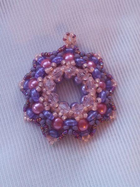 Kela medal pendant crystals pearls pink purple