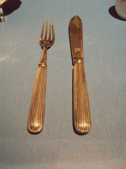 A fork and a knife recovered from the wreck of the RMS Titanic.