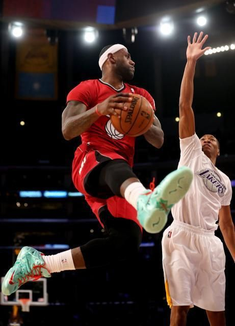 LeBron goes up with the ball against Wesley Johnson of the Lakers 12/25/2013.  I sure like those shoes!!!
