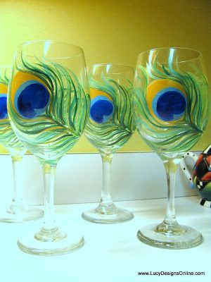 How to Paint on Glass, Hand Painted Peacock Feather Wine Glasses from The Dollar Store DIY... I need to make these!