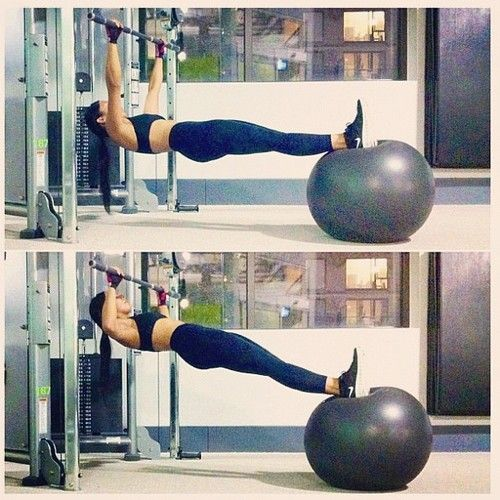CHALLENGE of the week: Stability Ball Rack Chins by @msflorendo. Don't be fooled - it's much harder than it looks! This is a great exercise to build strength and tone your arms and back while working your core. Body weight exercises are a MUST in your workout regimen - they show you how really strong you are. ✳ HOW TO: (1) Grab a stability ball and get under a Smith Machine rack. (2) Grab the bar overhand (or underhand) and place 1 foot on the ball. When you have your balance, pl