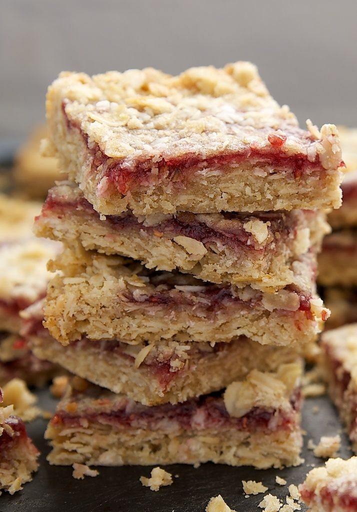 Raspberry Coconut Oat Bars feature layers of shortbread, preserves, and coconut for a lovely and delicious treat. - Bake or Break