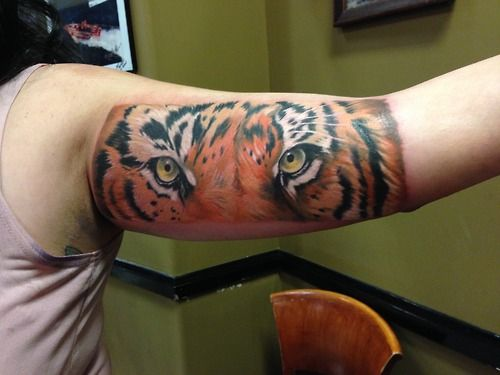 Realistic color tiger eyes tattoo by Monte Livingston @ Living Art Gallery Tattoo in San Clemente, CA. www.sclivingartgallery.com