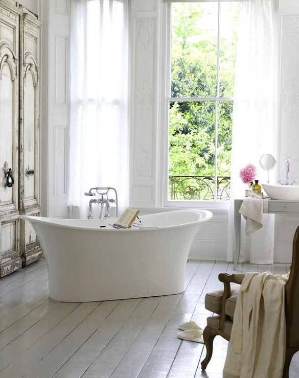 Suzie: Victoria + Albert Baths - Stunning French bathroom with white washed wood floor, ...