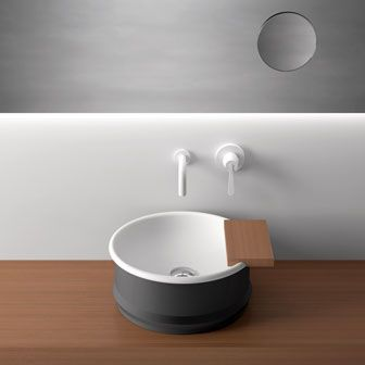 Agape - Vieques  Patricia Urquiola had old-fashioned bathtubs in mind when designing Vieques. The two-tone countertop sink, made with steel, measures 15 ¾ inches across and 7 ½ inches deep; the teak shelf is optional. Also available in a pedestal version and in all-white. 39-376-250-311; agapedesign.it.